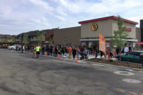 Fans lined up around the block of a Taco John's franchise.