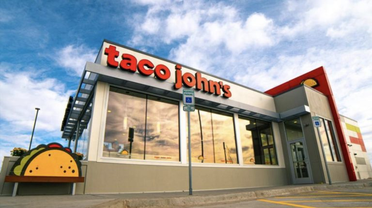 "The new prototype for Taco John's features elements such as more windows and the ""taco emoji"" bench outside the restaurant."